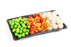 A plate of pickles. Peas, mushrooms and onions Royalty Free Stock Image