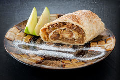 Plate with a piece of apple strudel Stock Photo