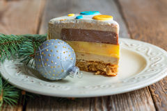 Plate with a piece of cake and a Christmas ball. Royalty Free Stock Photos