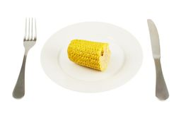 Plate with a piece of cornstick isolated Royalty Free Stock Photography