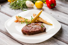 Plate with piece of meat. Royalty Free Stock Photography
