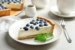 Plate with piece of tasty blueberry cake stock photography