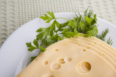 Plate with pieces cheese Royalty Free Stock Images