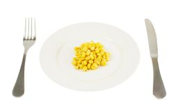 Plate with a pile of corn kernels isolated Stock Photography