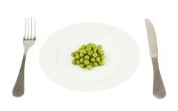 Plate with a pile of peas isolated Stock Photos