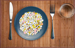 Plate with pills Royalty Free Stock Images