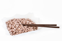 Plate with pills and chopsticks Royalty Free Stock Photos