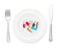 Plate with pills, fork and knife Stock Photo