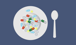 Plate with pills. And spoon. The concept of medicine Stock Photo