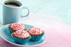 Plate with pink chocolate pralines and cup of coffee Royalty Free Stock Photo