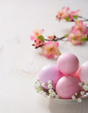 Plate  with pink   Easter eggs. Royalty Free Stock Image