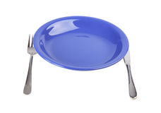 Plate with a plug and a knife Royalty Free Stock Photos