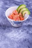Plate with poke, place for text. Rice, red fish and avocado. Hawaiian dish conquered the world Royalty Free Stock Photography