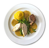 Plate with polenta, lamb and poultry Royalty Free Stock Images