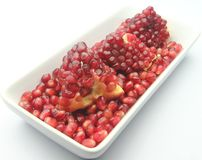 A Plate of Pomegranate Seeds. On White Back Ground Royalty Free Stock Photos