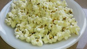 A plate of popcorn Stock Image