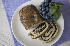 Plate of poppy strudel and blueberry stock images