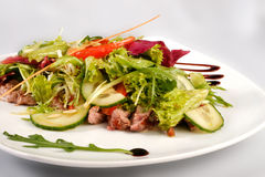 A plate of pork with vegetables. File includes clipping path for easy background removing Royalty Free Stock Photos