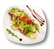 A plate of pork with vegetables Royalty Free Stock Photos