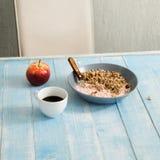 Plate porridge with yogurt, coffee and apple. Healthy breakfast Stock Images