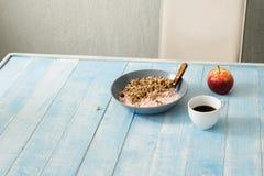 Plate porridge with yogurt, coffee and apple. Healthy breakfast Stock Photos
