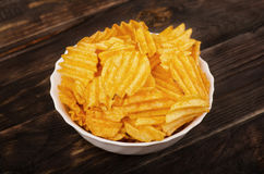 Plate of potato chips Stock Photo