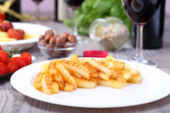 Plate with potato and food background Royalty Free Stock Photo