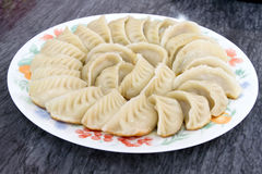 Plate of Potstickers Chinese Dumplings Royalty Free Stock Images