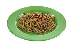Teriyaki Noodles Green Plate. A plate of prepared beef flavored teriyaki noodles Royalty Free Stock Images