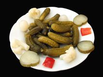 Plate of preserved vegetables and pickled cucumber Stock Photos