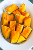 Plate pumpkin roasted in the oven and seasoned with olive oil an Stock Photography
