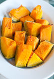 Plate pumpkin roasted in the oven and seasoned with olive oil an Royalty Free Stock Photo