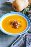 A plate of pumpkin soup with a jamon, garlic, thyme and cream Stock Images