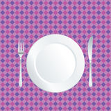 Plate on purple tablecloth Stock Photo