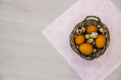 Plate with quail eggs and chicken eggs. Quail eggs in a wooden bowl. place for text. nutrition protein diet. Top view, flat lay wi Stock Image