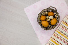 Plate with quail eggs and chicken eggs. Quail eggs in a wooden bowl. place for text. nutrition protein diet. Top view, flat lay wi Royalty Free Stock Photography