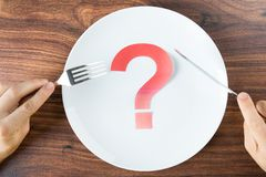 Plate with a question mark on desk Stock Images