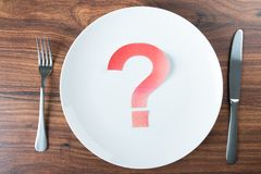 Plate with a question mark on desk Royalty Free Stock Image