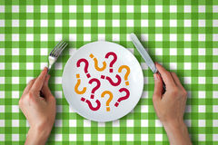 Plate with question marks Stock Photos