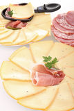 Plate of raclette cheese Stock Photo