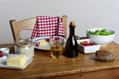 Plate with radish and butter on a rustic table. Plate with radish , butter and cider on a rustic table Royalty Free Stock Photo