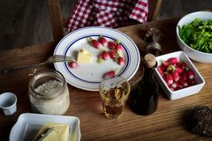 Plate with radish and butter on a rustic table. Plate with radish , butter and cider on a rustic table Royalty Free Stock Photography