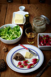 Plate with radish and butter. On a table Stock Images