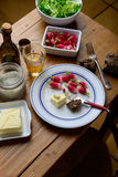 Plate with radish and butter. On a table Royalty Free Stock Photo