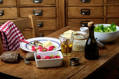 Plate with radish and butter on a table. Plate with radish, butter and salad on a table Stock Photos