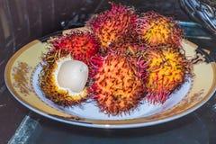 Plate of rambutan. A plate of spiky rambutan fruits Royalty Free Stock Image