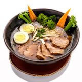 Plate of Ramen Soup with noodles and beef. Isolated on white background Stock Photos