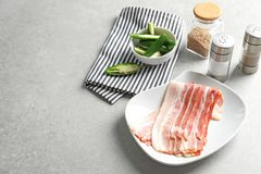 Plate with rashers of bacon. On table Stock Photo