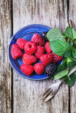 Plate of raspberries and blackberries Stock Photos
