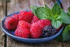 Plate of raspberries and blackberries Royalty Free Stock Image